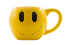 Smiley Cup/Mug. Smiley Face Series: Bright yellow smiley/happyface mug coffee cup on white background Royalty Free Stock Photo