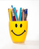 Smiley cup pen holder Royalty Free Stock Photography