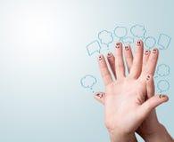 Smiley de doigt avec des bulles de la parole. Image stock
