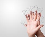 Smiley de doigt avec des bulles de la parole. Photos stock