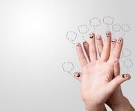 Smiley de doigt avec des bulles de la parole Photographie stock libre de droits