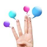 Smiley de doigt avec les bulles colorées de la parole Photos stock