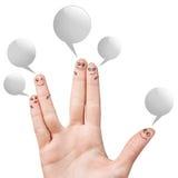 Smiley de doigt avec les bulles colorées de la parole Photo stock