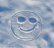 Smiley in de sneeuw wordt geschilderd die Royalty-vrije Stock Foto's