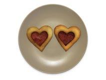Smiley in de vorm van platen met koekjes, op witte achtergrond worden geïsoleerd die Royalty-vrije Stock Afbeeldingen