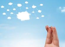 Smiley del dito con il sistema di rete della nuvola Immagine Stock
