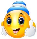 Smiley del emoticon de la historieta que lleva un casquillo y un donante pulgares para arriba Fotografía de archivo