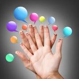 Smiley del finger con las burbujas coloridas del discurso Fotos de archivo libres de regalías