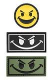 Smiley della toppa, toppa sorridente arrabbiata Immagini Stock Libere da Diritti