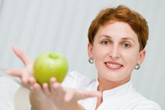 Smiley dentist with apple Stock Photo