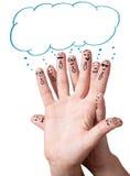 Smiley do dedo com bolhas do discurso. Imagens de Stock