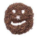 Smiley drôle des grains de café avec un nez de la tresse d'isolement sur le fond blanc Photographie stock