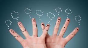 Smiley drôles de doigt avec des bulles Photos stock
