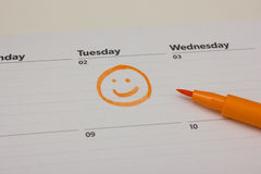 Smiley drawing on calender. Orange smiley drawn on calender Stock Image