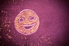 Smiley drawn chalk on an old school board Stock Image