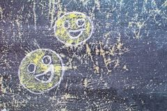 Smiley drawn chalk on an old school board Royalty Free Stock Photography