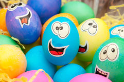 Smiley easter eggs in a holiday basket arrangement.  stock photography