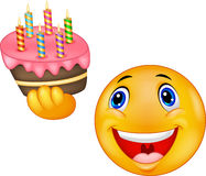 Smiley Emoticon, der Geburtstagskuchen hält Stockbilder