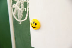 Smiley emoticon on the desk. Photo of smiley emoticon on the desk Stock Photography