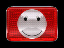 Smiley emoticon red button or headlight Stock Image