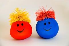smiley för 2 färgrik framsidor Royaltyfri Fotografi