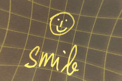 Smiley face. A yellow smiley face and the word smile Royalty Free Stock Image
