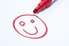 Smiley face. Drawn on white with red pen showing customer satisfaction stock photo