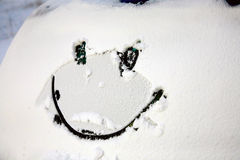 Smiley face. Drawing on snow on winter Stock Photography