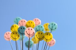 Smiley face. On blue sky background royalty free stock image