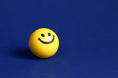 Smiley face. On a blue background Stock Photography