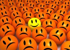 Smiley Face. Between a lot of sad faces Royalty Free Stock Images