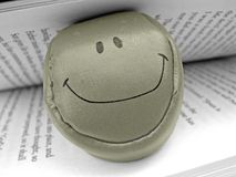 Smiley face ball in book Stock Photo