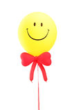 Smiley face baloon with a red bow tie Royalty Free Stock Photo