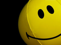 Smiley face beach ball. Peeking in from the right Royalty Free Stock Images