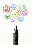 smiley face bubbles coming out of pen Royalty Free Stock Photography
