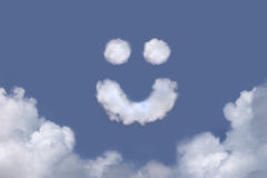 Smiley Face Clouds. Smiley face shaped cloud in a bright blue sky stock images