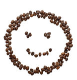 Smiley Face and Coffee. Smiley face made from fresh coffee beans on a white background Stock Photography