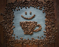 Smiley face from coffee beans at stone background Royalty Free Stock Photo