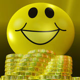 Smiley Face With Coins Showing Monetary Happiness Stock Photography
