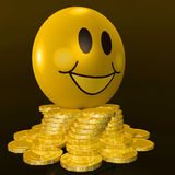 Smiley Face With Coins Shows Profitable Earnings Royalty Free Stock Images