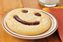 Smiley face cookie Stock Image