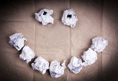 Smiley Face Crumpled Paper Balls Stock Photo
