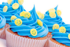 Smiley face cupcakes. Cupcakes decorated with yellow smiley face sprinkles stock photography