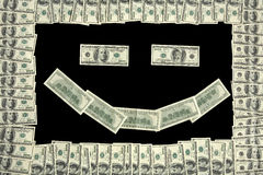 Smiley face in dollar bill frame Stock Photography