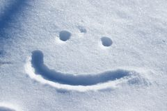 A smiley face drawing on a snow. Closeup of a smiley face drawing on a snow stock photos
