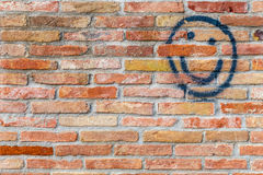 Smiley face drawn  on a brick wall Royalty Free Stock Photo