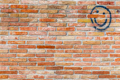 Smiley face drawn  on a brick wall Stock Photos