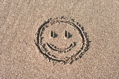 Smiley Face Drawn On Beach Sand Stock Photography