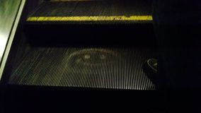 Smiley Face on the Escalator Royalty Free Stock Photography