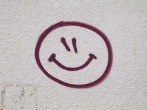 Smiley face graffiti drawn on wall Stock Photo